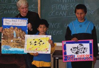 Robert & Ames from Maketu School and Carole Long from Te Puke Forest & Bird show the winning posters