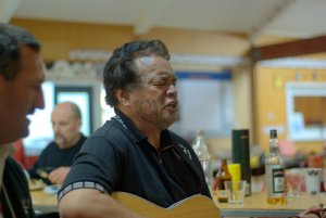 One of the Pou Kura Taiao, Joe Harawira, jammin' in the whare-kai.