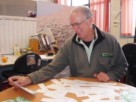 Image of DOC area manager, Ian McClure, selecting finalists - and laughing.