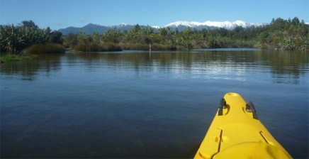 A kayak on the trail on a sunny day in the Okarito lagoon.