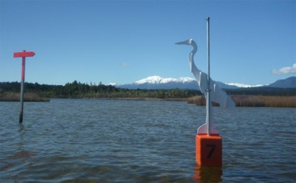 White heron sculpture stands along the kayak trail to mark the route.