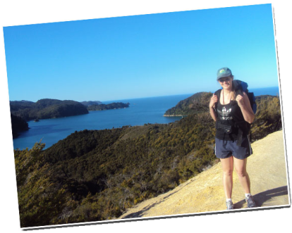 Siobhan in front of a scenic view of Abel Tasman Coast.