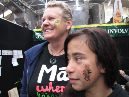 Robyn and Mavis at the Sika Show in Taupō with a kowhai and weta painted on their faces.