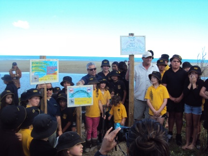 Doug, Haami and the Ahipara with some of their signs.