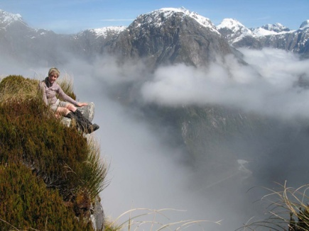 Bronwyn sitting on the overhang at Mackinnon Pass.