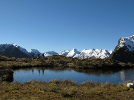 The lake at Mackinnon Pass with mountains in the background.