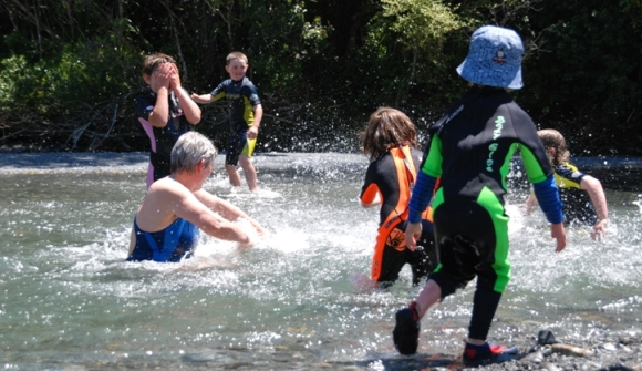 Kids swimming in a river in the Rimutaka Forest Park.