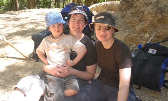 Ligs Hoffman, son and partner take a break in Rimutaka Forest Park.