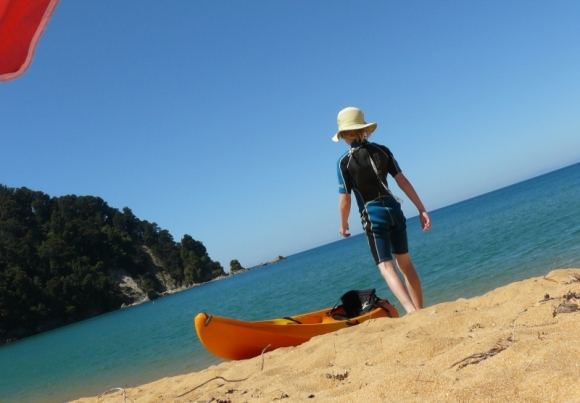 Kayak on the beach at Totaranui campground.