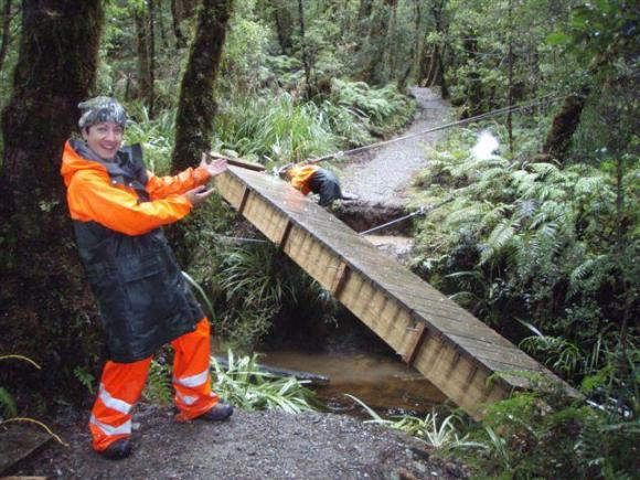 DOC rangers fix the bridge on the Lake Ellery Track.