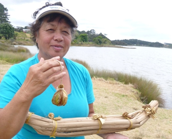 Whaea Betsy with the poi and waka she made.
