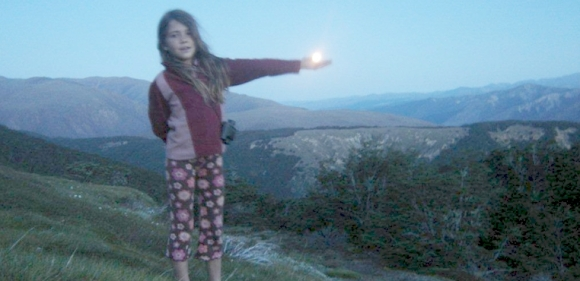 Emma holds the moon in her hand.