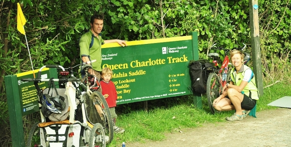 Chrissy and her family by the DOC Queen Charlotte Track sign.