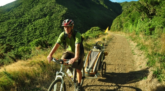 Phil riding along the Rimutaka Rail Trail with the chariot.