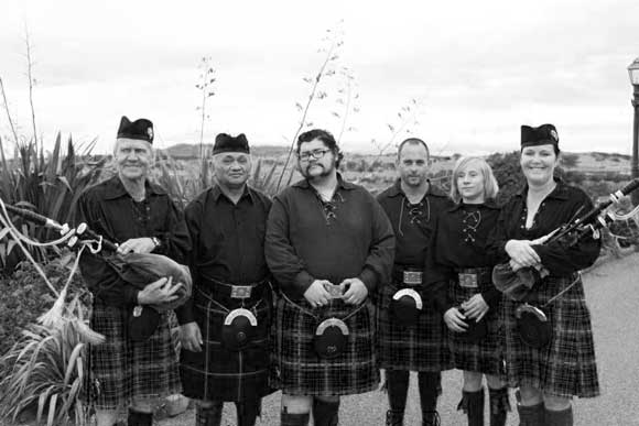Rebecca (right) and the Westhighland Pipe Band.