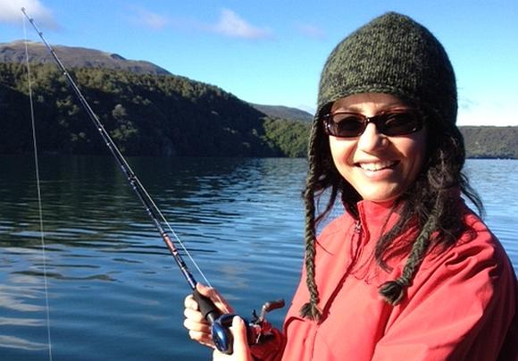 Huia fishing on Lake Tarawera.