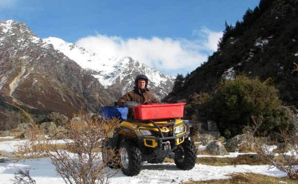 Glen Currall on a quad bike while working in the Tasman Valley.