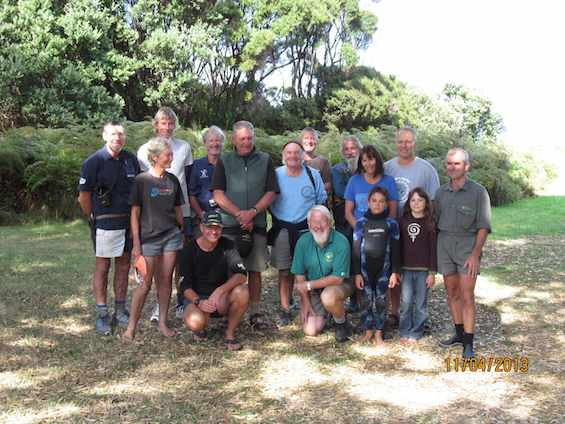The first group of cat hunters return. Standing left to right: Dave Garrick, Alice Murman, Tom Hardy, Richard Anderson, Terry Hatch, Geordie Murman, Rex Page, Leigh Joyce, Liam Walle, Phil Thompson, Mahina Walle, Richard Walle. Crouched left to right: Matt McDougal, Dick Veitch.