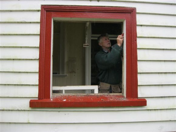 Paul preparing the Port Craig Hut window frame for a replacement.