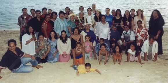 Huia's whanau at a wedding on a beach.