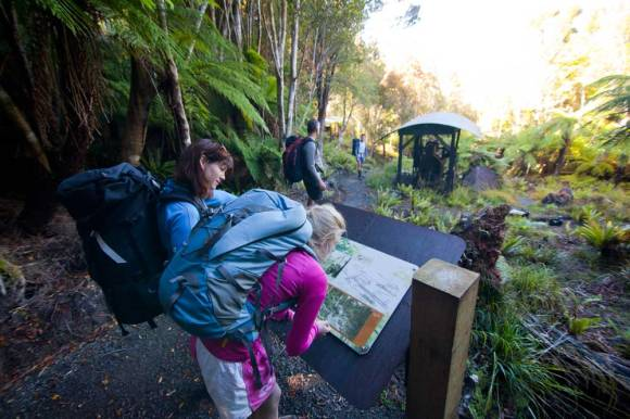 Trampers enjoying history on the Rakiura Track.