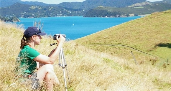 Claudia setting up her camera in the Bay of Plenty hills.