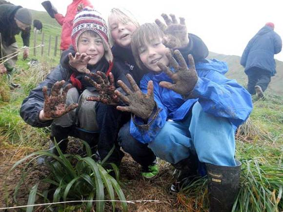 Mucking in! Raumati South and Paraparaumu Beach School students get involved in a Living Legends planting project at Whareroa Farm on the Kapiti Coast, near Paraparaumu.