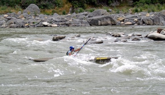 Carolyn racing along Rangitikei River.