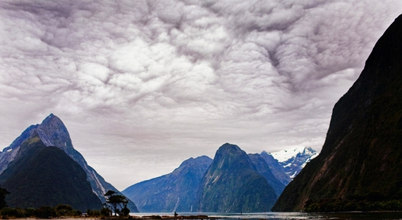 Milford Sound with storm brewing. Photo by Jonas Seaman via Flickr. Creative Commons.