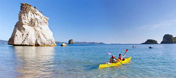 Kayakers exploring Te Whanganui-a-hei (Cathedral Cove). Photo: Rob Suisted © | naturespic.com | DOC USE ONLY.