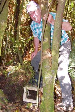 Volunteer standing with a completed nesting box. Photo: Natasha Perry.