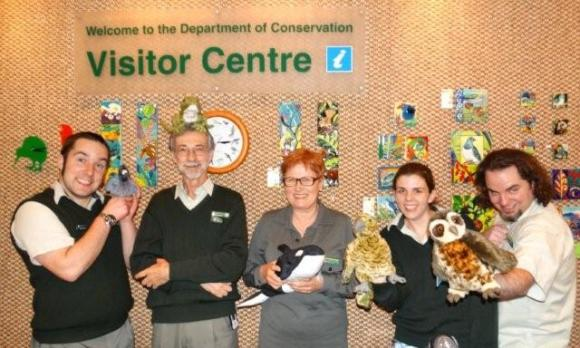 The National Visitor Centre staff pose with toy birds.