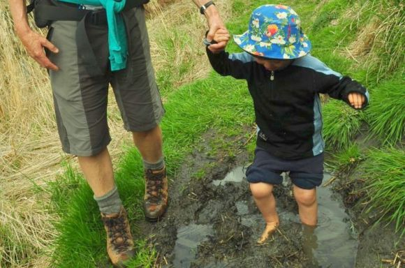 Chrissy's son playing in the mud.