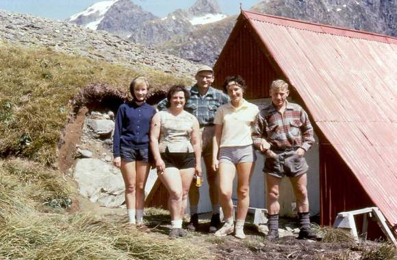 People standing outside Mackinnon Pass Shelter No 2 during late 1950s.