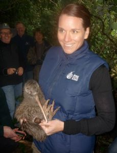 Michelle Impey holding a rowi kiwi.