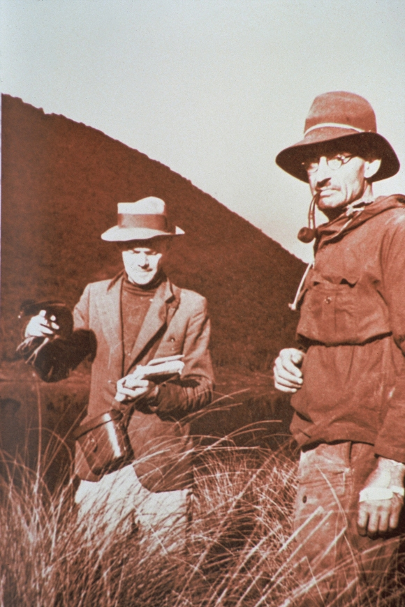 Takahe Expedition, photo of Dr R. Falla (left) holding takahe chick and Dr G.B. Orbell (right), Takahe Valley, Fiordland. Original photo probably taken by J. H. Sorenson.