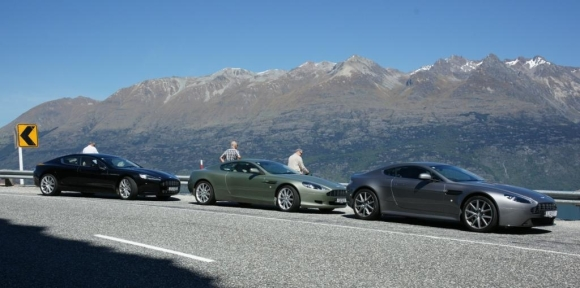 Greg's Aston Martin and two other vehicles.