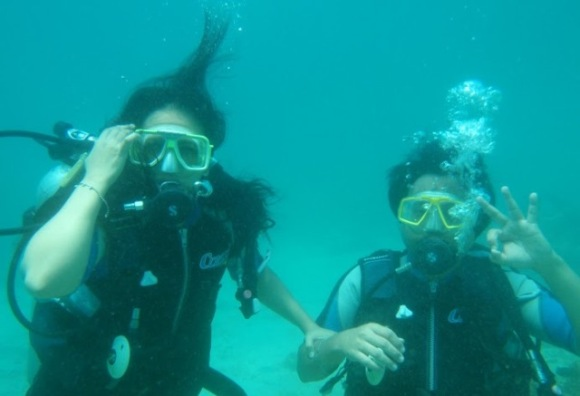 Ofelia open water diving with her husband at Puerto Galera, Philippines.