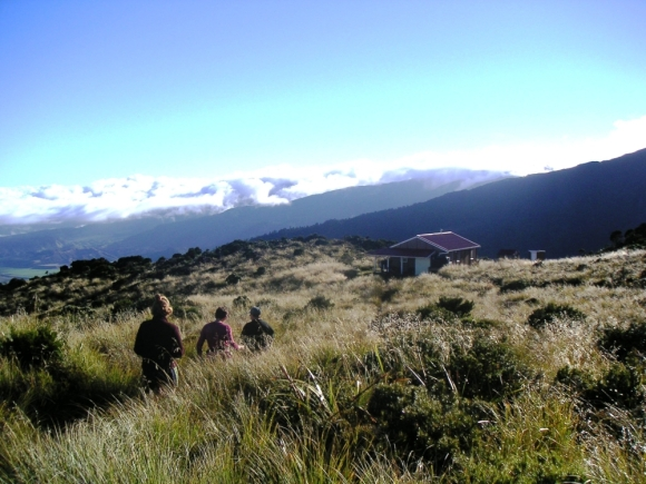 A group reaching Rangiwahia Hut.