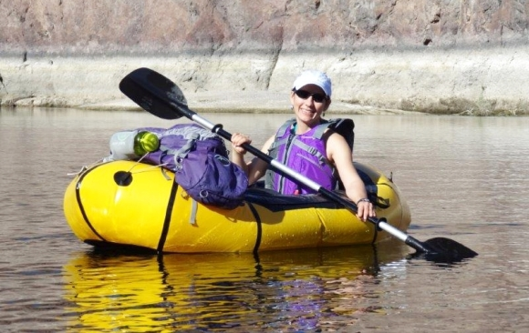 Jen packrafting in the Colorado River.