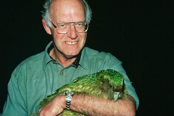 """Don Merton holding kakapo """"Richard Henry""""."""