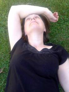 Melissa lying on the grass relaxing at the Chatto Creek Tavern.  Photo: Ged Taylor.