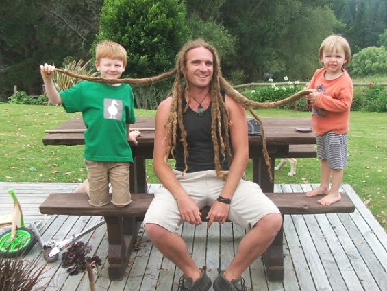 James with his nephews Leo and Luca— before chopping off his dreads.