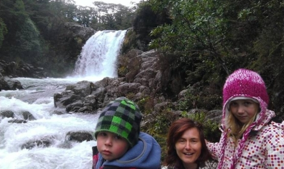 Kirsten Ralph with her two children at a waterfall.