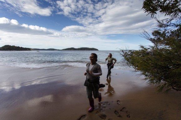 Leana and a friend running along the beach on Ulva Island.