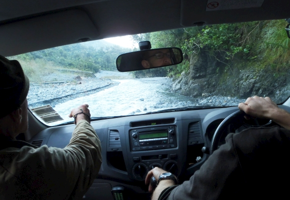 Driving the DOC ute off-road beside a stream in Rimutaka Forest Park.
