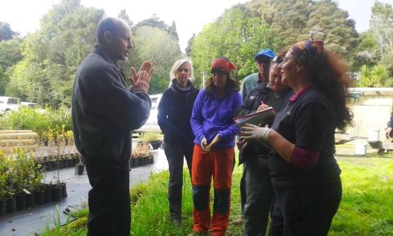 Group talking with Roger at the Shadehouse, Kerikeri.