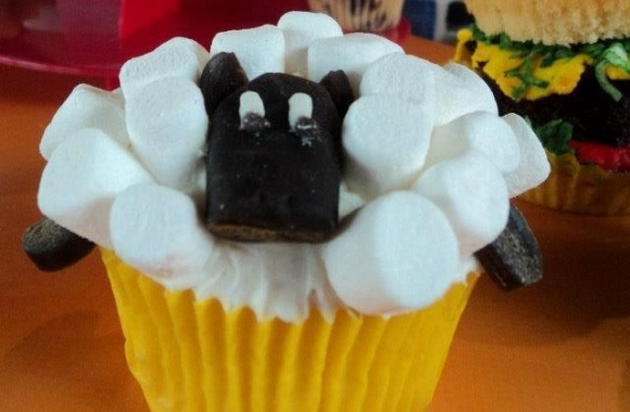 Cupcake shaped like a sheep.