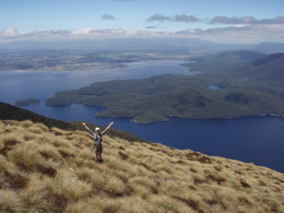 Caroline in the Murchison Mountains with Te Anau in the background.