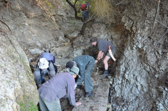 Staff and volunteers clear a blocked channel and re-open a section of bridging.